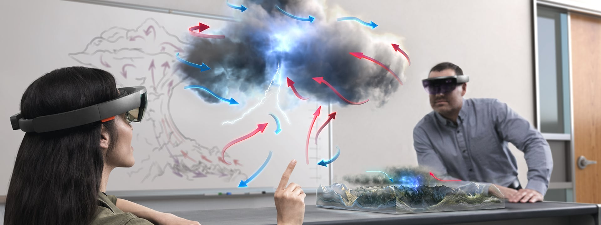 An image of a pair of people standing altogether far too close to a holographic thundercloud diagram.